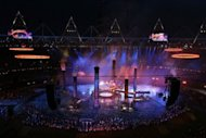 "The Olympic rings are assembled above the stadium in a scene depicting the Industrial Revolution during the London Olympics opening ceremony on July 27. The ceremony was lauded as a ""whimsical, riotous and very British"" spectacle and an ""obvious retort"" to the tight discipline seen in Beijing by Australia's press Saturday"