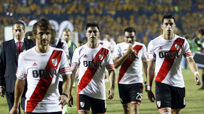 Players of Argentina's River Plate leaves the field after the first leg of their Copa Libertadores final soccer match against Mexico's Tigres