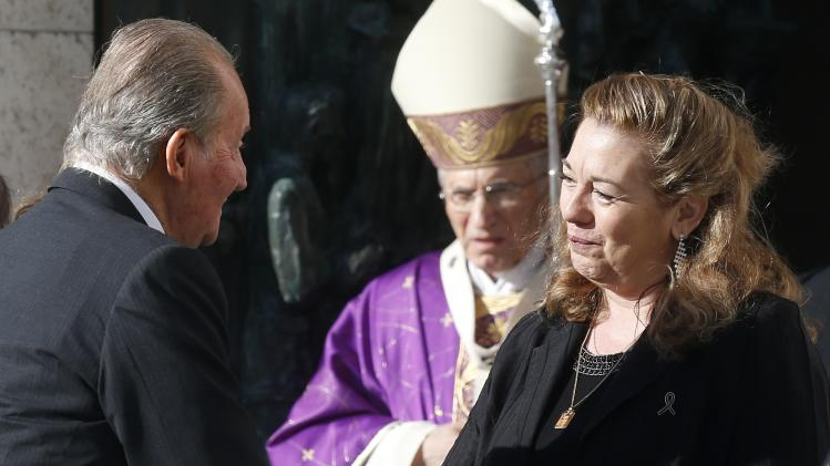 Spanish King Juan Carlos greets Manjon after arriving for a memorial mass in the Almudena cathedral on the 10th anniversary of the Madrid train bombings
