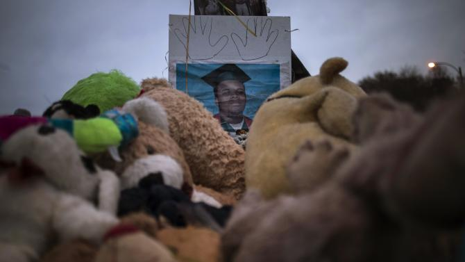 Image of 18-year-old teenager Michael Brown is seen at a makeshift memorial near the site where he was shot and killed in Ferguson, Missouri
