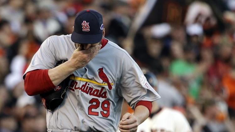 St. Louis Cardinals starting pitcher Chris Carpenter reacts after giving up a triple to San Francisco Giants' Brandon Belt during the second inning of Game 6 of baseball's National League championship series Sunday, Oct. 21, 2012, in San Francisco. (AP Photo/David J. Phillip)