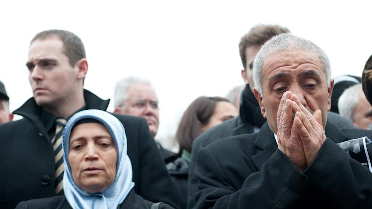 FILE - In this April 6, 2013 file picture Ismail  Yozgat , right, and  Ayse Yozgat , left, pray at a memorial event on the seventh anniversary of the murder of their son Halit, who was killed by the NSU terror group, in Kassel, Germany. Beate Zschaepe, the sole survivor of a neo-Nazi group _ the self-styled National Socialist Underground _ blamed for ten killings goes on trial Monday, May 6, 2013 in Munich, along with four men alleged to have helped the killers in various ways. Beate Zschaepe, 38, is charged with complicity in the murder of eight Turks, a Greek and a policewoman. She is also accused of involvement in at least two bombings and 15 bank robberies carried out by her accomplices Uwe Mundlos and Uwe Boenhardt, who died in an apparent murder-suicide two years ago   (AP Photo/dpa,Uwe Zucchi,File)EARLY RISER FOR FRIDAY MAY 3 2013 -