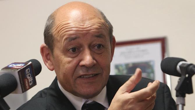 French Defense Minister Jean-Yves Le Drian speaks during a press conference in Kabul, Afghanistan, Monday, June 11, 2012. The defense minister said the recent deaths had not altered France's withdrawal plan, but stressed that some French forces would stay to help train Afghan security forces and help manage the airport in Kabul. About 1,400 French soldiers are expected to remain. (AP Photo/Musadeq Sadeq)