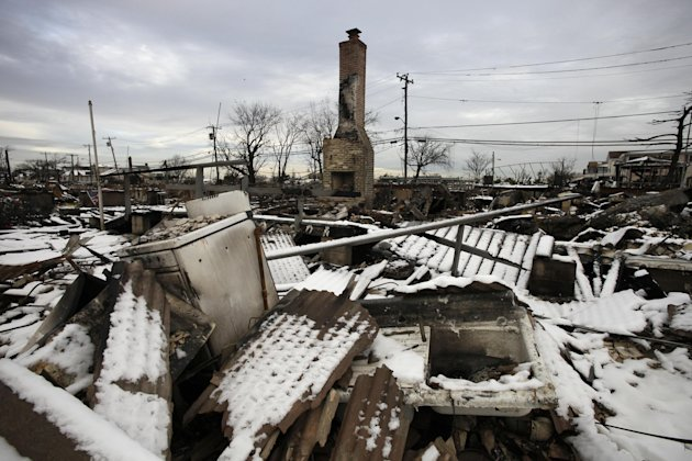 A fire-scorched landscape of Breezy Point is shown after a Nor'easter snow, Thursday, Nov. 8, 2012 in New York.  The beachfront neighborhood was devastated during Superstorm Sandy when a fire pushed b