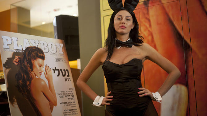 "A model dressed as a Playboy bunny poses with the first Hebrew language edition of the popular men's magazine in Tel Aviv, Israel, Tuesday, March 5, 2013. Israelis can now read Playboy ""for the articles."" A U.S. emigre, Daniel Pomerantz, on Tuesday launched the first Hebrew language edition of the popular men's magazine. Playboy has been widely available in Israel for years, but this marks the first local edition of the magazine. It features Israeli models and articles by Israeli writers. It's not clear how well the magazine will be received in the Holy Land, where religious sensitivities simmer under the surface and observant Jews and Muslims live by strict modesty rules. Adult magazines and videos are freely available, but not with local models and not in Hebrew. Playboy was launched in 1953 with the iconic Marilyn Monroe centerfold. It peaked in popularity in the 1970's. Circulation has declined since the rise of adult Internet sites. (AP Photo/Ariel Schalit)"