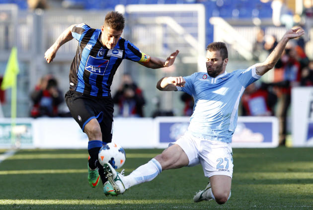 Atalanta forward German Gustavo Denis, of Argentina, left, is tackled by Lazio defender Lorik Cana, of Kosovo, during a Serie A soccer match between Lazio and Atalanta, at Rome's Olympic stadium,