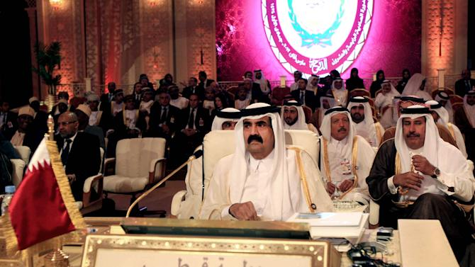 Emir of Qatar Sheik Hamad Bin Khalifa Al Thani, center, attends the opening session of the Arab League Summit in Doha, Qatar, Tuesday, March 26, 2013. Syrian opposition representatives took the country's seat for the first time at an Arab League summit that opened in Qatar on Tuesday, a significant diplomatic boost for the forces fighting President Bashar Assad's regime. (AP Photo/Ghiath Mohamad)