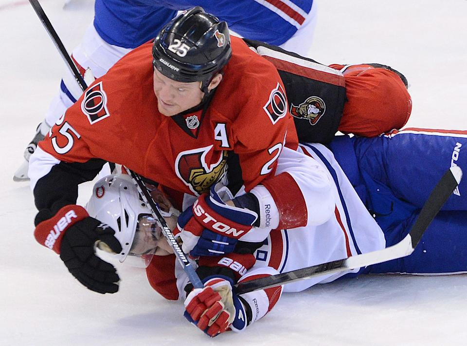 Ottawa Senators' Chris Neil pushes Montreal Canadiens' Max Pacioretty to the ice during the second period of game three of first round NHL Stanley Cup playoff hockey at the Scotiabank Place in Ottawa on Sunday, May 5, 2013. (AP Photo/The Canadian Press, Sean Kilpatrick)