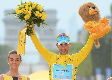 Astana team rider Nibali of Italy celebrates his overall victory on the podium after the 137.5 km final stage of the 2014 Tour de France, from Evry to Paris Champs Elysees