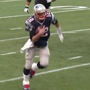 New England Patriots quarterback Tom Brady busts a move