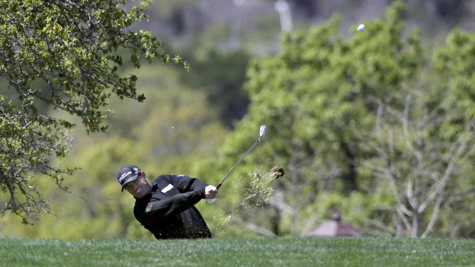 Padraig Harrington, of Ireland, hits from the rough on the 18th hole during the first round of the Texas Open golf tournament, Thursday, April 4, 2013, in San Antonio.  (AP Photo/Eric Gay)