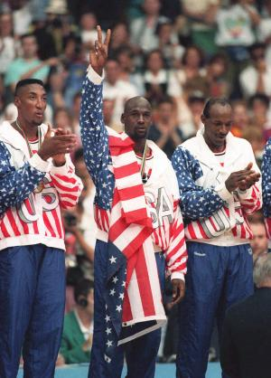 "FILE -In this Aug. 8, 1992 photo, the USA's Scottie Pippen, left, with Michael Jordan, center, and Clyde Drexler, pose with their gold medals after beating in Barcelona. Jordan tells the Associated Press that  he laughed when heard Kobe Bryant said this year's USA Olympic basketball team could beat the Dream Team that Jordan played on. Jordan said ""It's not even a question"" who would have won that game. ""We had 11 Hall of Famers on that team. Whenever they get 11 Hall of Famers you call and ask me."" (AP Photo/Susan Ragan)"