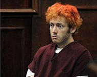 <p>James Holmes appears in court at the Arapahoe County Justice Center July 23 in Centennial, Colorado. The suspected Batman massacre gunman was seeing a psychiatrist specializing in schizophrenia before the attack that killed 12 in Colorado, court documents showed Friday.</p>