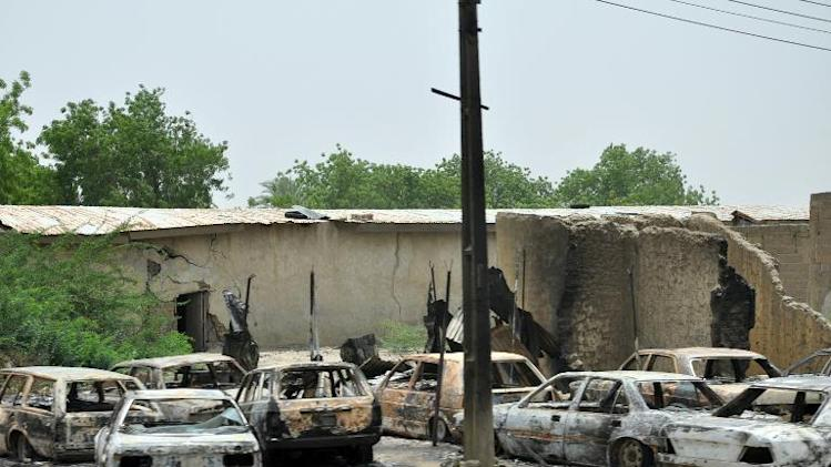 Burnt vehicles stand on May 11, 2014, in Ngumborum village, Borno State in northeastern Nigeria, as a result of a Boko Haram attack