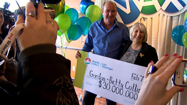 Gordon and Betty Collins speak with reporters in St. John's after collecting their $30-million Lotto Max cheque.