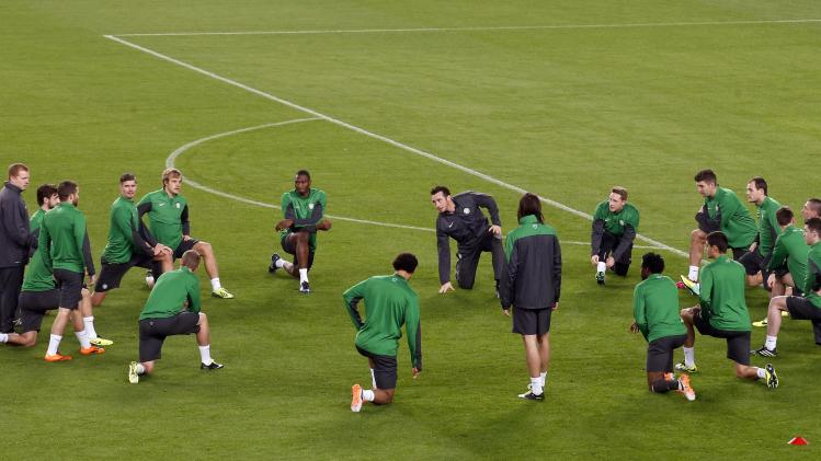 Celtic's players stretch during a training session at Camp Nou stadium in Barcelona