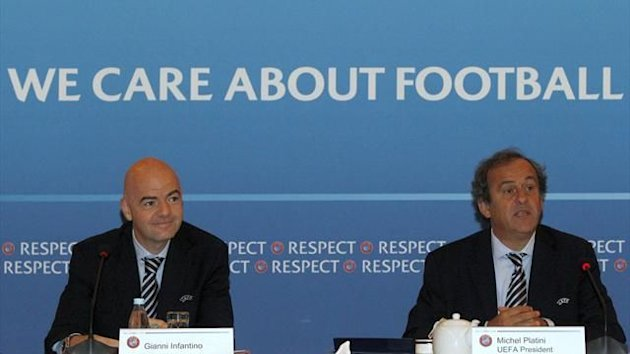 UEFA President Michel Platini (R) and UEFA General Secretary Gianni Infantino (Reuters)