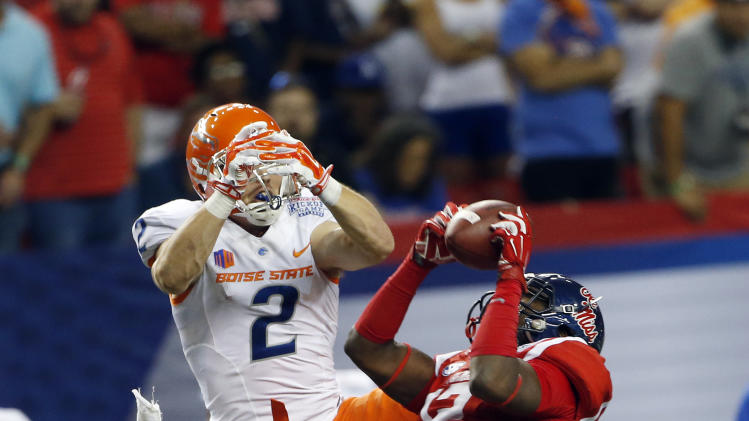 Mississippi defensive back Tony Conner (12) intercepts a pass intended for Boise State wide receiver Matt Miller (2) in the first half of an NCAA college football game Thursday, Aug. 28, 2014, in Atlanta. (AP Photo/John Bazemore)