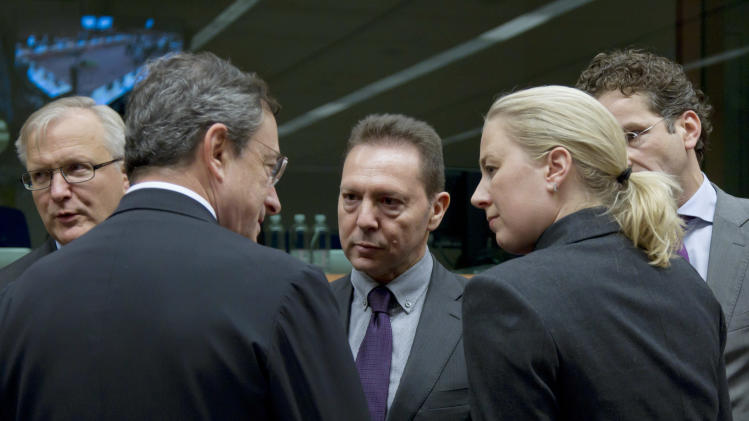 From left, European Commissioner for the Economy Olli Rehn, European Central Bank President Mario Draghi, Greek Finance Minister Yannis Stournaras, Finland's Finance Minister Jutta Urpilainen and Dutch Finance Minister Jeroen Dijsselbloem during a meeting of eurogroup finance ministers in Brussels on Tuesday, Nov. 20, 2012. European Union officials will make a fresh try Tuesday to reaching a political accord on desperately needed bailout loans to Greece, an agreement that eluded them last week. (AP Photo/Virginia Mayo)