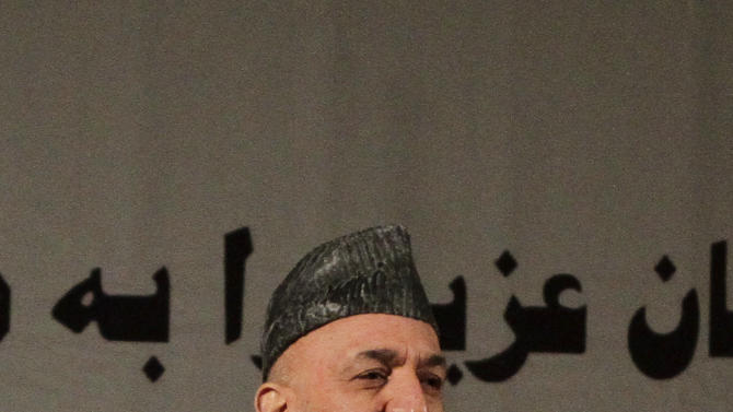 Afghan President Hamid Karzai delivers a nationally televised speech about the state of Afghan women in Kabul, Afghanistan, Sunday, March, 10, 2013. Karzai on Sunday accused the Taliban and the U.S. of working in concert to convince Afghans that violence will worsen if most foreign troops leave as planned by the end of next year. Karzai says two deadly suicide bombings on Saturday show the insurgent group is conducting attacks to help show that international forces will still be needed to keep the peace after their current combat mission ends in 2014. (AP Photo/Ahmad Jamshid)