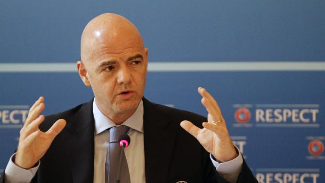 UEFA General Secretary Gianni Infantino gestures during a press conference after the UEFA Executive Committee meeting in Prague, Czech Republic, Tuesday, June 30, 2015. UEFA has decided that the Champions League final will be played in Wales for the first time in 2017 at Cardiff's Millennium Stadium. (AP Photo/Petr David Josek)