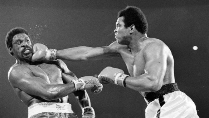 FILE - In this May 16, 1975, file photo, Muhammad Ali hits Ron Lyle, left, with a hard right to the chin during fifth round action of the title bout in Las Vegas. Lyle, who fought Muhammad Ali for the title in 1975 and later battled George Foreman, died Saturday, Nov. 26, 2011, in Denver, a Salvation Army official said. He was 70.  (AP Photo/File