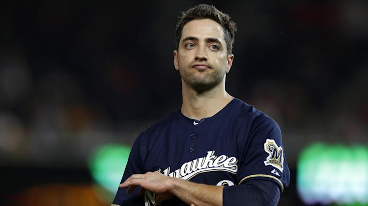 FILE - In this Sept. 21, 2012, file photo, Milwaukee Brewers Ryan Braun reacts while holding his elbow after missing his swing during a baseball game against the Washington Nationals at Nationals Park in Washington. Braun says he used the person who ran the Florida clinic now under investigation by Major League Baseball as a consultant on his drug suspension appeal last year and nothing more.  Yahoo Sports reported Tuesday, Feb. 5, 2012, that his name showed up three times in records of the Biogenesis of America LLC clinic.  (AP Photo/Jacquelyn Martin, FIle)