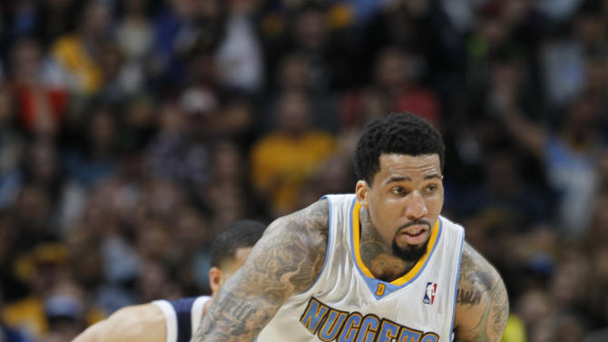 Denver Nuggets forward Wilson Chandler, front, picks up a loose ball in front of Oklahoma City Thunder guard Kevin Martin in the fourth quarter of the Nuggets' 105-103 victory in an NBA basketball game in Denver on Friday, March 1, 2013. (AP Photo/David Zalubowski)