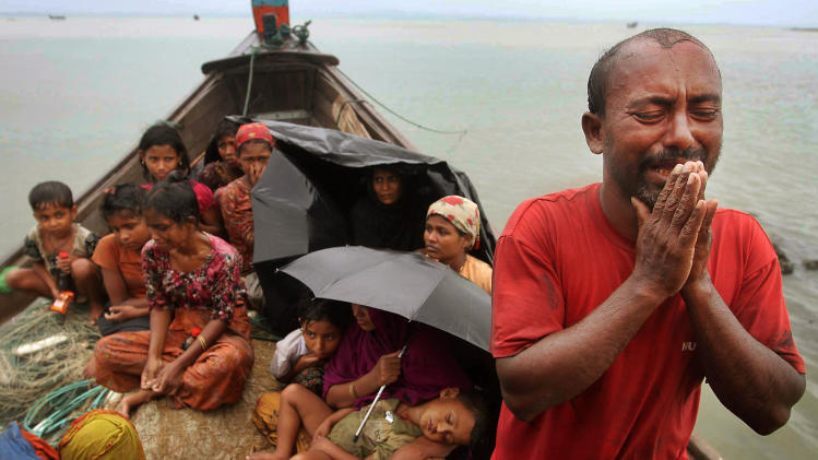 FILE - In this June 13, 2012 file photo, a Rohingya Muslim man who fled Myanmar to Bangladesh to escape religious violence, cries as he pleads from a boat after he and others were intercepted by Bangladeshi border authorities in Taknaf, Bangladesh. Asia's more than 1 million ethnic Rohingya Muslims are considered by rights groups to be among the most persecuted people on earth. Most live in a bizarre, 21st-century purgatory without passports, unable to travel freely or call any place home. The Myanmar government regards Rohingyas mostly as illegal migrants from Bangladesh, while Bangladesh rejects them just as stridently.  (AP Photo/Anurup Titu, File)