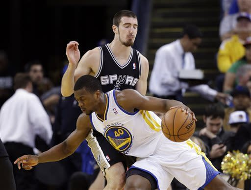 Curry leads Warriors past Spurs, 116-106