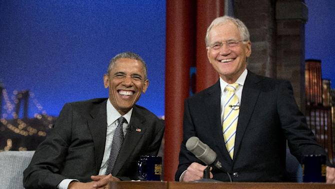 """President Barack Obama with host David Letterman smile during a break at a taping of CBS The Late Show with David Letterman at the Ed Sullivan Theater in New York, Monday, May 4, 2015. Obama traveled to New York to announced the creation of an independent nonprofit organization that is a spin off his """"My Brother's Keeper"""" program, to tape a segment on Letterman's show and to do fundraising for the Democratic party. (AP Photo/Pablo Martinez Monsivais)"""