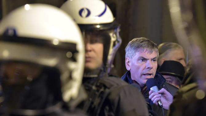 Dewinter talks to the press as members of the Belgian branch of PEGIDA take part in a demonstration in Antwerp