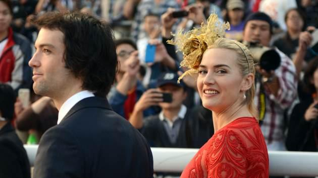 Ned Rocknroll and Kate Winslet attend the Longines Hong Kong Cup Race at the Hong Kong International Races at the Shatin racecourse in Hong Kong, December 9, 2012 -- Getty Images