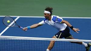 Ferrer of Spain lunges to make a shot at the net against Kukushkin of Kazakhstan at the U.S. Open tennis championships in New York