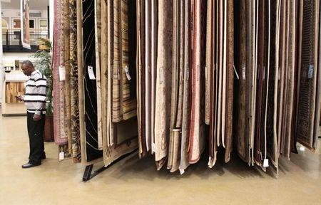 File image of a man near a display of carpets while shopping at a Home Depot store in New York
