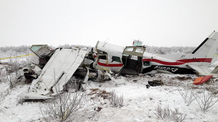 This image provided Saturday Nov. 30, 2013, courtesy of Alaska State Troopers shows the wreckage of a plane that crashed Friday near St. Marys, Alaska. Authorities said the pilot and three passengers died in this crash of the single-engine turboprop Cessna 208. Few other details, including the possible cause of the crash, are known. (AP Photo/Alaska State Troopers()