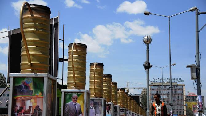 FILE -In this riday Feb. 22, 2013,  file photo large posters of late  Ethiopian leader Meles Zenawi are displayed  one of the street in Addis Ababa. Ethiopia's long-ruling leader died half a year ago, but it seems Meles Zenawi still holds on to power. In the capital, his face looks down from hundreds of posters plastered on walls, and government representatives vow to implement the late Meles' vision without alteration.  (AP Photp/Elias Asmare, File)