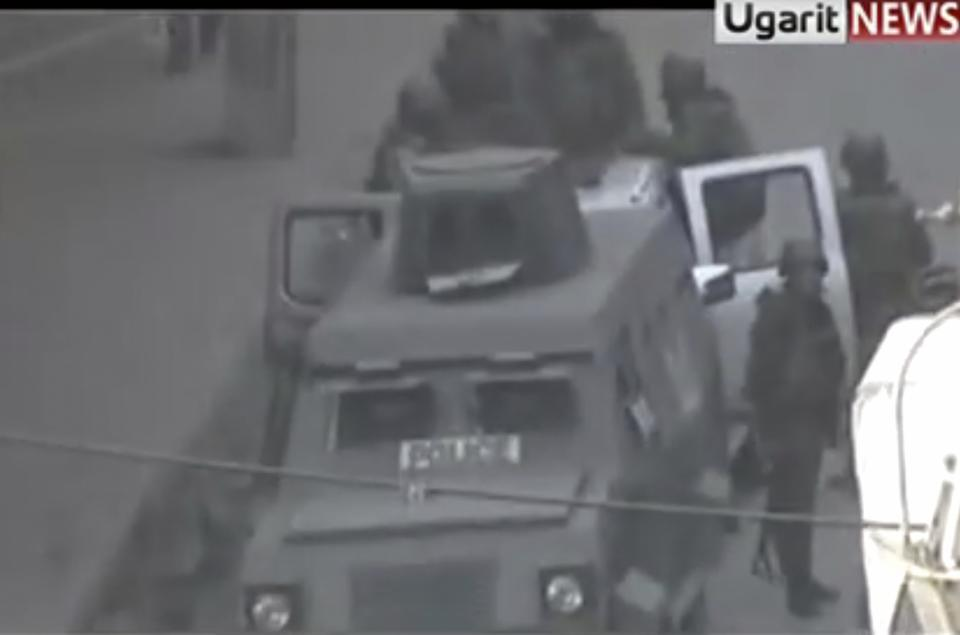 This image made from amateur video and made available by Ugarit News Group Thursday Dec. 22, 2011, purports to show an armored vehicle in Damascus, Syria. (AP Photo/Ugarit News Group via APTN) THE ASSOCIATED PRESS CANNOT INDEPENDENTLY VERIFY THE CONTENT, DATE, LOCATION OR AUTHENTICITY OF THIS MATERIAL.  TV OUT