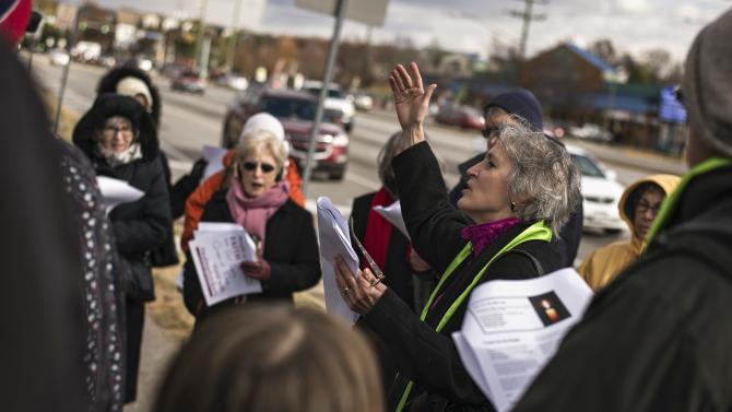 Kim Bobo of Interfaith Worker Justice leads a Black Friday protest against Walmart's labor practices in Alexandria, Virginia
