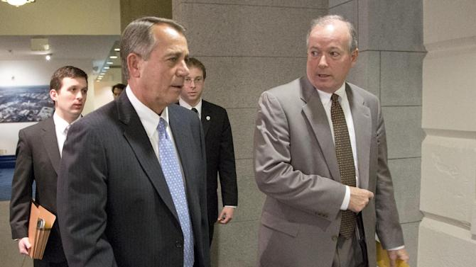 Speaker John Boehner of Ohio, left, arrives, with Ed Cassidy, his director of House Operations, for a House Republicans meeting on Capitol Hill, Thursday, Dec. 20, 2012 in Washington. Confronted with a revolt among the rank and file, House Republicans abruptly put off a vote Thursday night on legislation allowing tax rates to rise for households earning $1 million and up.(AP Photo/Alex Brandon)