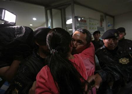 Lorenzana greets a relative after arriving at the Supreme Court of Justice in Guatemala City