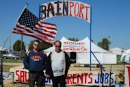 Sensata Technologies workers stand at a protest camp in Freeport, Illinois to illustrate what they say will happen to the United States if Mitt Romney wins the election. Republican Mitt Romney hits the campaign trail hard this week to try to inject some fresh momentum into his flagging presidential bid as polls show his path to the White House narrowing