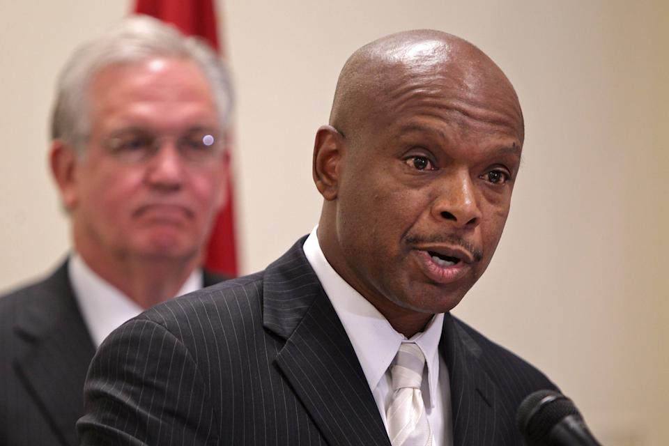 Former St. Louis Police Chief Dan Isom, left, speaks after he is named the director of the Missouri Department of Public Safety during a news...