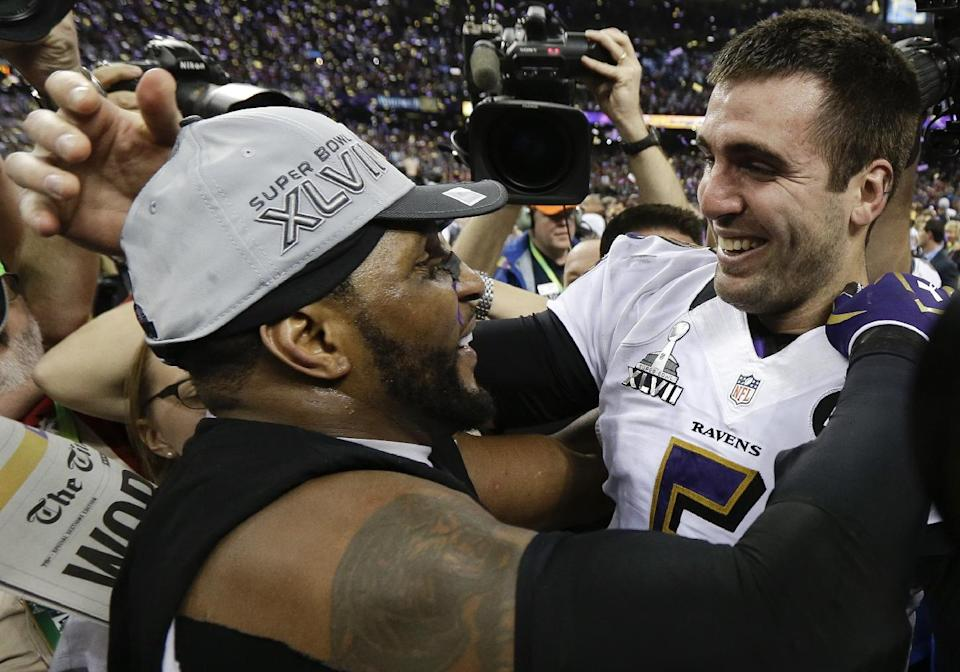 Baltimore Ravens linebacker Ray Lewis, left, and quarterback Joe Flacco celebrate their 34-31 win against the San Francisco 49ers in the NFL Super Bowl XLVII football game, Sunday, Feb. 3, 2013, in New Orleans. (AP Photo/Julio Cortez)
