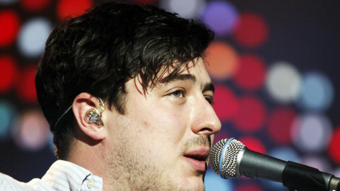 Marcus Mumford of Mumford and Sons performs at the Motorpoint Arena in Cardiff in Wales on Thursday, Dec. 14, 2012. (Photo by Jim Ross/Invision/AP)