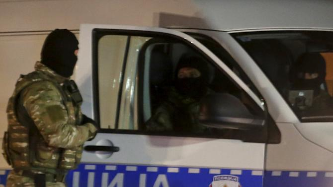 Special police take position in front of a police station that had been attacked in Zvornik