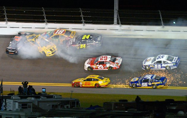 Denny Hamlin (11), Jimmie Johnson, second from left, Kyle Busch (18) and Jeff Gordon (24) collide in Turn 2 during the NASCAR Daytona Shootout auto race at Daytona International Speedway in Daytona Be