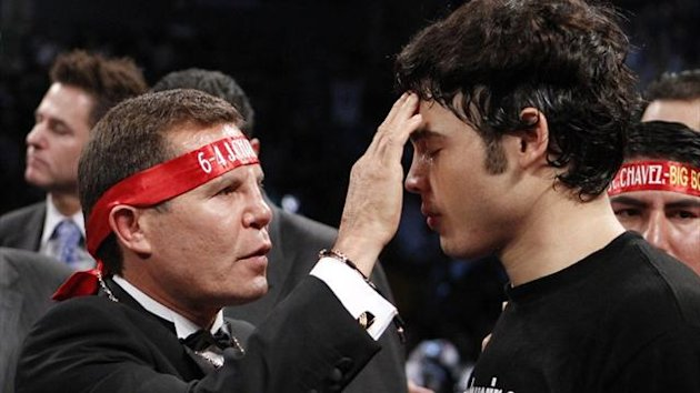 Julio Cesar Chavez Sr. blesses his son Julio Cesar Chavez Jr. before a fight in 2011 (Reuters)