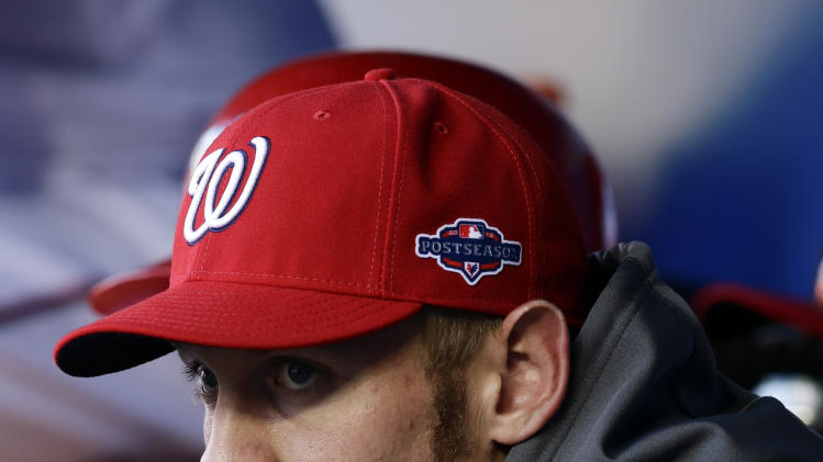 Washington Nationals pitcher Stephen Strasburg looks on from the dugout in the sixth inning of Game 3 of the National League division baseball series against the St. Louis Cardinals on Wednesday, Oct. 10, 2012, in Washington. (AP Photo/Alex Brandon)