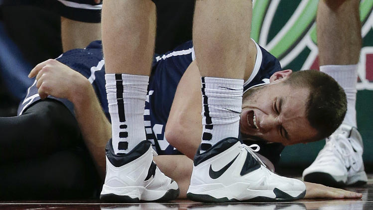 BYU's Kyle Collinsworth cringes in pain after an injury during the second half against Gonzaga in an NCAA college basketball game for the West Coast Conference men's tournament title, Tuesday, March 11, 2014, in Las Vegas. Collinsworth left the game and did not return. Gonzaga won 75-64. (AP Photo/Julie Jacobson)